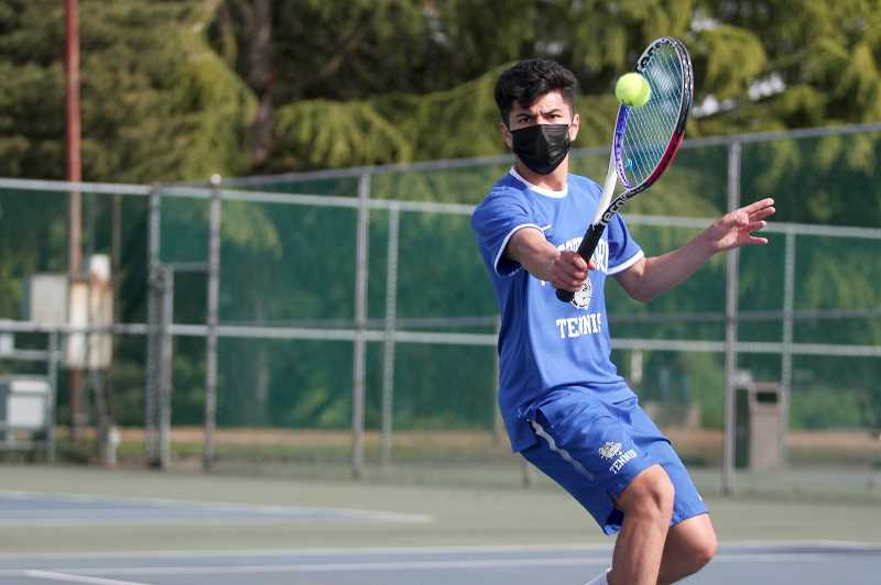 PMG FILE PHOTO: PHIL HAWKINS - Woodburn senior Jonathan Swenson gives the Bulldogs their first singles qualifier in the state tournament since 2015.