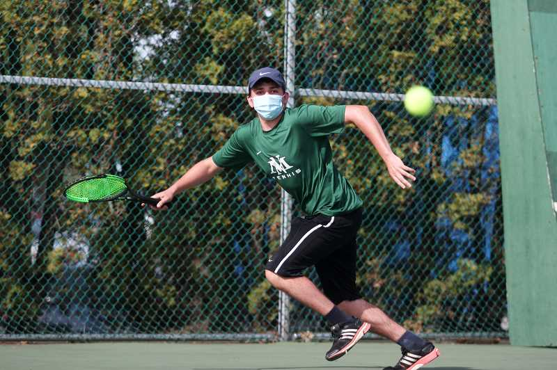 PMG FILE PHOTO: PHIL HAWKINS - North Marion junior Gage Hurst qualified for the 2021 4A state tennis showcase after beating his first three district opponents and advancing to the semifinals.