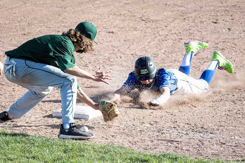 LON AUSTIN - Tyler Martinez goes headfirst into third base during the Cowboys' 11-1 loss against Pendleton May 11. The Buckaroos finished unbeaten in Intermountain Conference play. The young Crook County squad wound up 1-9 in league, 1-14 overall. They played Redmond in a postseason game on Monday.