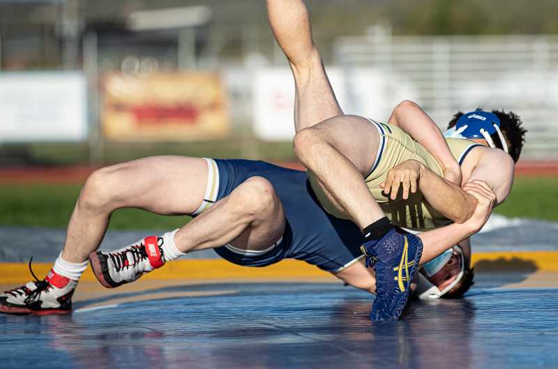 LON AUSTIN - Cash Wells, in the blue singlet, and Garett Cobb go at it during the Crook County wrestling program's Blue & Gold Scrimmage Saturday. The event was outside, at Ward Rhoden Stadium. Wells eventually won by pin.