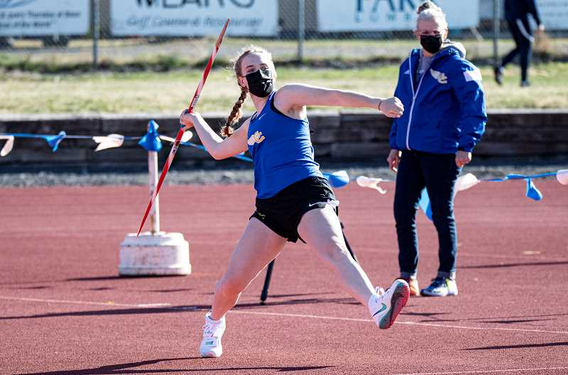 LON AUSTIN - Jose Kasberger, shown in a meet earlier in the season, won the javelin and discus and took second in the shot put to lead an excellent throwing performance by the Cowgirls, leading them to the IMC district title.