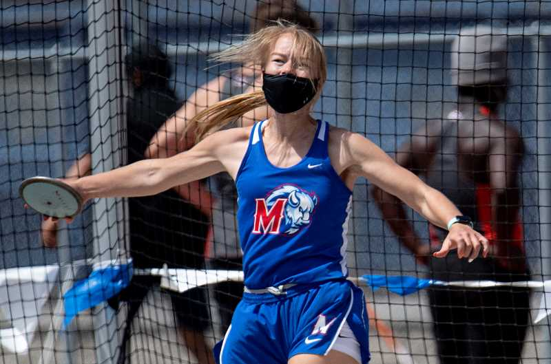 LON AUSTIN  - Matty Buck gives it her all during the discus. She finished second in the the event in the Tri-Valley Conference District Championships, held in Madras May 14-15.