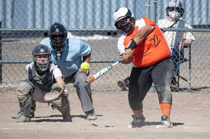 LON AUSTIN  - Culver's Shanti Rosales smacks a pitch against La Pine's JVs. The Bulldogs won both ends of the doubleheader, 15-9 and 12-2.