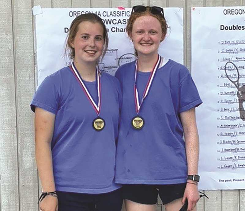 COURTESY PHOTO: MIKE CLARKE - The Molalla HIgh School tennis team's top doubles pair, Hannah Nelzen and Alyssa Beatty, captured the Class 4A girls doubles state title Tuesday afternoon at Marist High School.