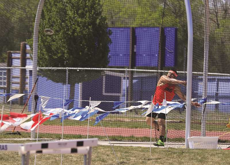 COURTESY PHOTO: MOLALLA TRACK - Benjamin Suarez thew the discus to a third place finish at the district meet recently.