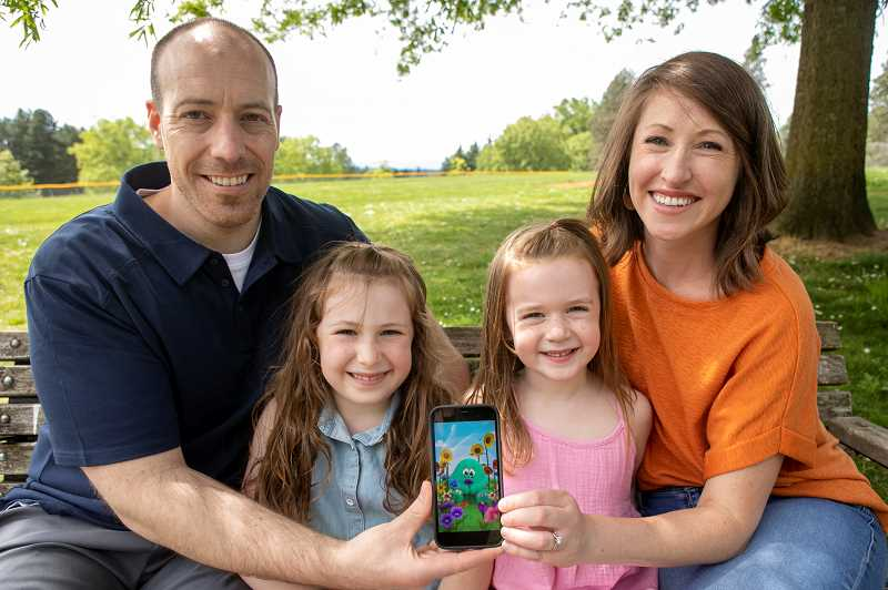 PMG PHOTO: JAIME VALDEZ - John and Kristi Coppa with their daughters at Gabriel Park. The couple recently developed and launched Wondergrade, a phone app that uses a character named Yog to guide kids through exercises that help them learn to manage emotions and calm down.