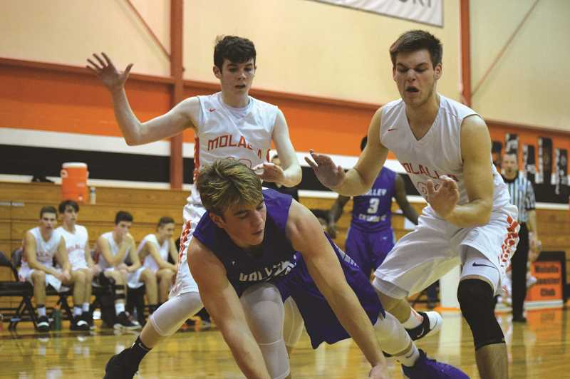 FILE PHOTO - The Molalla boys basketball team opened its 2021 season May 18 with a win over Madras.