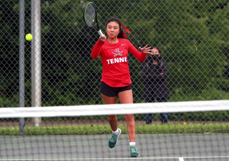 PMG PHOTO: MILES VANCE - Clackamas freshman Lauren Han returns a shot during her first singles victory in the Mt. Hood Conference tournament at Clackamas High School on Monday, May 17.