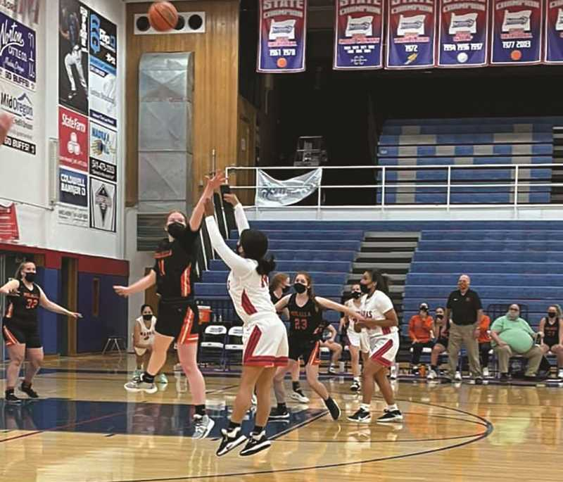 COURTESY PHOTO: MOLALLA GIRLS BB - Molalla's girls basketball team opened its season with a 53-49 loss to Madras on May 20.