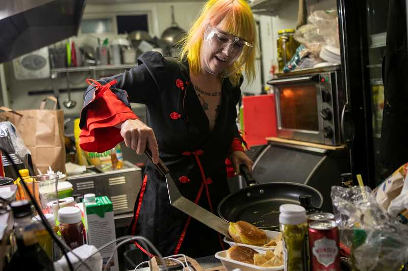 PMG PHOTO: JAIME VALDEZ - When she has time, Strawberry Pickle cooks vegan food at the CyberCat Cafe food cart at her club Rainbow City. Hater Tots are popular, as is Grilt Cheez & Basil.