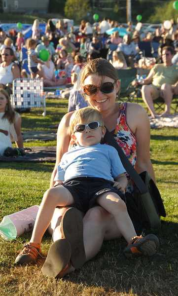 PMG FILE PHOTO - Attendees relax and listen to the tunes at West Linn's Music in the Park in 2013.