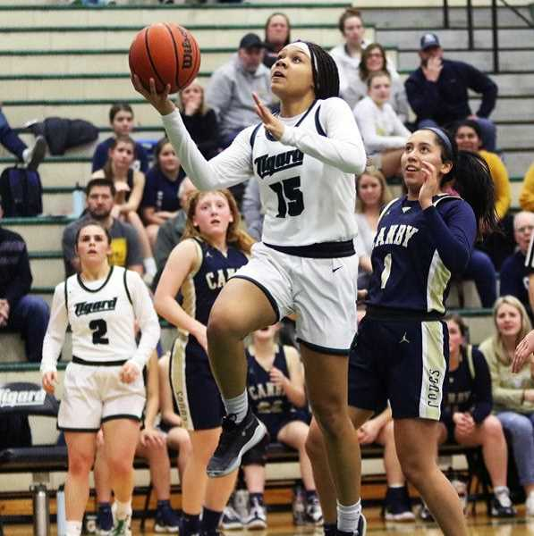 PMG FILE PHOTO - Ajae Holdman, then a junior, goes up to the basket in a Three Rivers League game with Canby, last year. Coach Heidi DeHaan says she's expecting good things from both Holdman and Sarah Lamet.