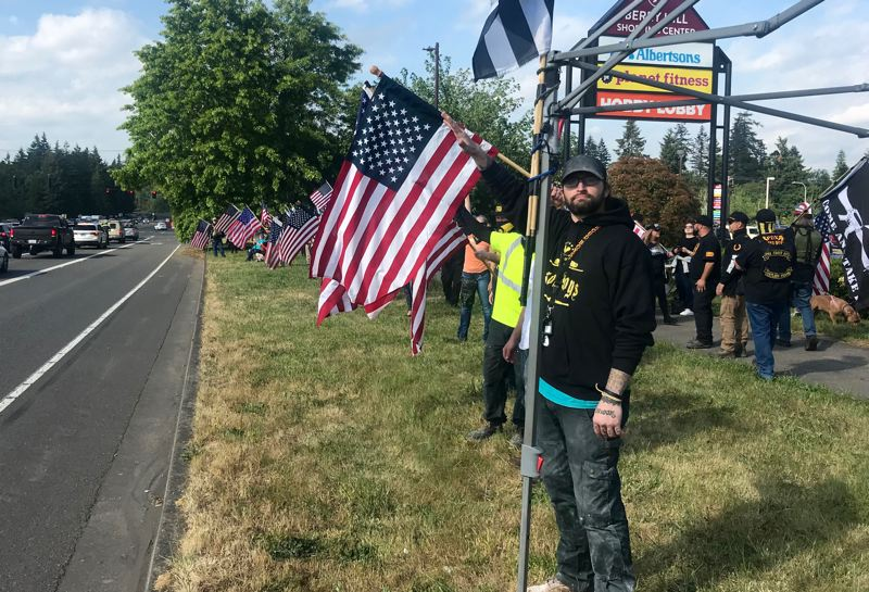 PMG PHOTO: ZANE SPARLING - A large contingent of Proud Boys attended a flag wave demonstration in Oregon City on May 21.