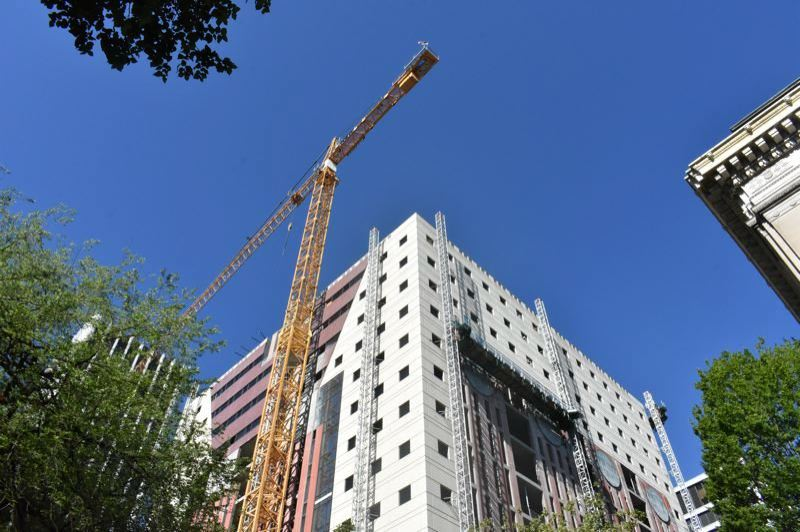 PMG FILE PHOTO - A construction crane assists with the renovation of the Portland Building in 2018.