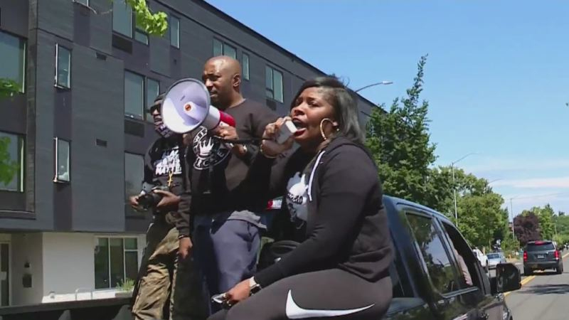 COURTESY KOIN 6 NEWS - March organizer Royal Harris, center, and other participants in Saturday's protest against increasing murders in Portland.