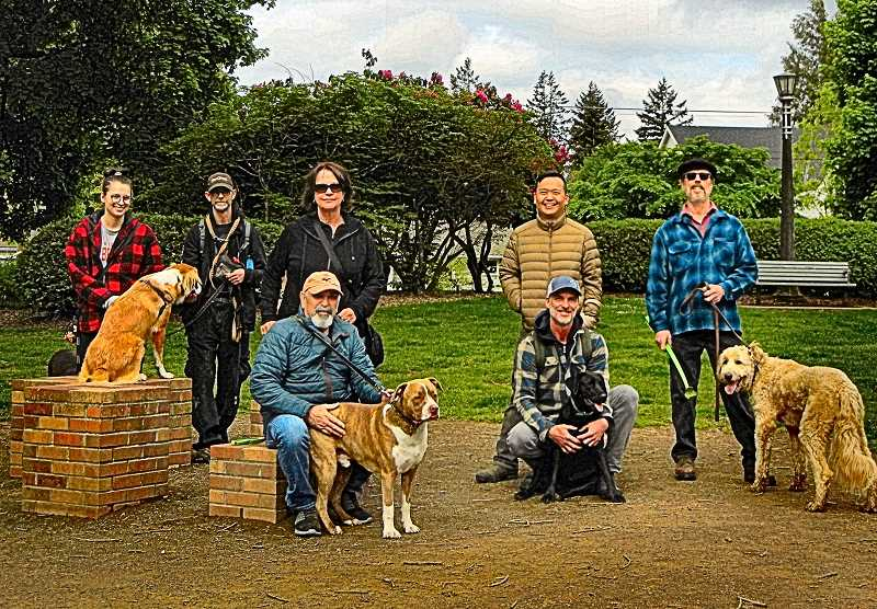 ELIZABETHY USSHER GROFF - At Woodstock Parks dog park area, on May 4th a few of the regulars gathered for a BEE photo with their canine friends. From left: Laura Rhude and Kevin Price with dog Bentley; Peggy and Bob St. John with Barley; Ryan Lee (standing) whose dog Dakota has momentarily run off,  and Bryan Ronshaugen (squatting) with Winnie; and at the end John Linder himself, with Kipper.