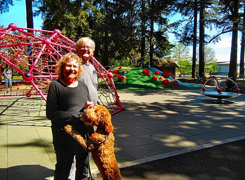 ELIZABETH USSHER GROFF - Janine and Mark Robben, whose house backs up to the park, are enjoying the renovated Creston Park playground and park improvements every day with their five-month-old Golden doodle Rufus by themselves - and during weekly visits from their grandchildren.