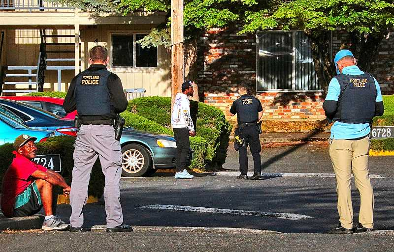 DAVID F. ASHTON - After a daytime shooting that seriously wounded the victim, officers interviewed a suspect in the parking lot of an apartment complex in the Brentwood-Darlington neighborhood.
