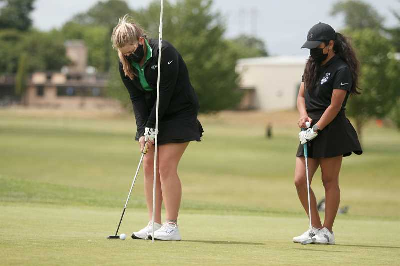 PMG PHOTO: PHIL HAWKINS - North Marion junior Vivan McCullough (left) led the Huskies with a 10th-place score of 90 in the single-day 4A state championship event at Trysting Tree Golf Club on May 19. Woodburns Ana Sanchez (right) shot a 120 at the event to place 47th.