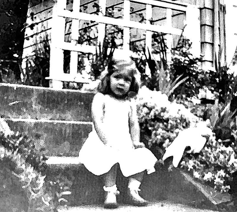COURTESY OF MARCIA SINGER - Young Marcia Singer is shown in 1954 on the steps of her grandparents house at 14th and S.E. Rex. Her great grandparents owned the onetime Caldwell Grocery Store in Sellwood; her parents lived in Westmoreland. This is Marcia in her innocent years - before she became a teenager, racing down the street on her red bike and throwing candy at the boys up front in the Moreland Theater.