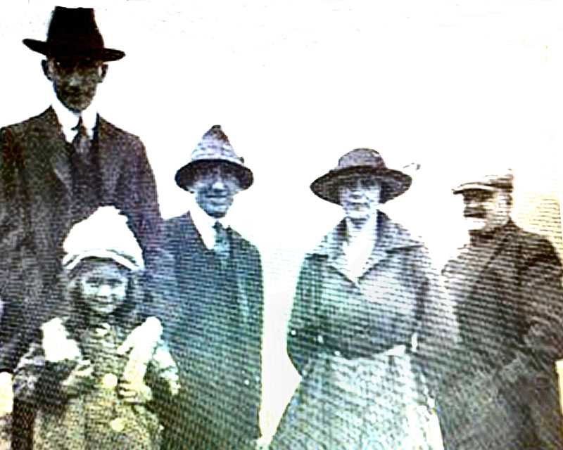 COURTESY OF MARCIA SINGER - Heres a three-generation photo of the Caldwell family. Clinton James Caldwell is at the far left; his daughter Elizabeth Caldwell Singer is in front of him; and his father, James Warren Caldwell -owner of Caldwells Grocery Store - is at the far right. The two people in the middle are unidentified.