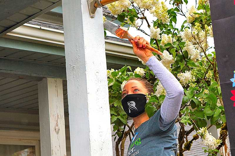 DAVID F. ASHTON - Typically, Hayley Andrews is a Rivermark Community Credit Union Community Development Specialist - but on Portland Rebuild Day, she was helping paint the home of an elderly woman in the Foster-Powell neighborhood.