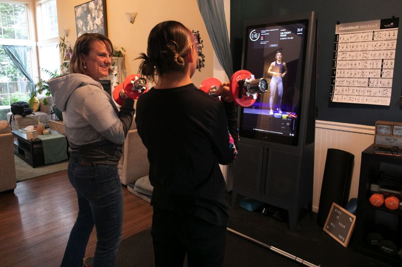 PMG PHOTO: JAIME VALDEZ - Monica Linder, a Second Home home provider, works out with her student, who was previously homeless before starting to live with Linder's family in Beaverton.