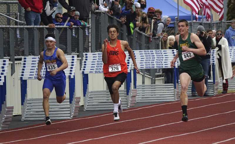 COURTESY PHOTO - Brayden Cunningham ran to fifth place in the coaches-organized Class 4A 'state' track meet at Siuslaw High School.