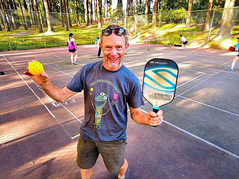 DAVID F. ASHTON - It doesnt take much to be a Pickleball player, says Sellwoods famed entertainer Henrik Bothe, whos showing off his new club T-shirt while holding his paddle, and a ball used in the game.