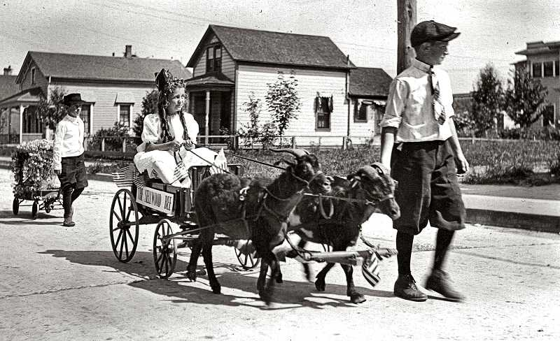 COURTESY OF SMILE HISTORY COMMITTEE - It was 1921 - exactly 100 years ago. This newspaper was already fifteen years old, and THE BEEs goat-powered wagon rolled by in what was apparently a neighborhood Rose Festival event. In its wake was a small rose-covered float built onto a smaller wagon.