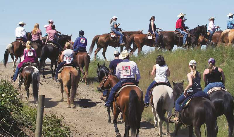 COURTESY PHOTO: ST. PAUL RODEO - The trail ride signals that that rodeo will soon return to the tiny Marion County town.