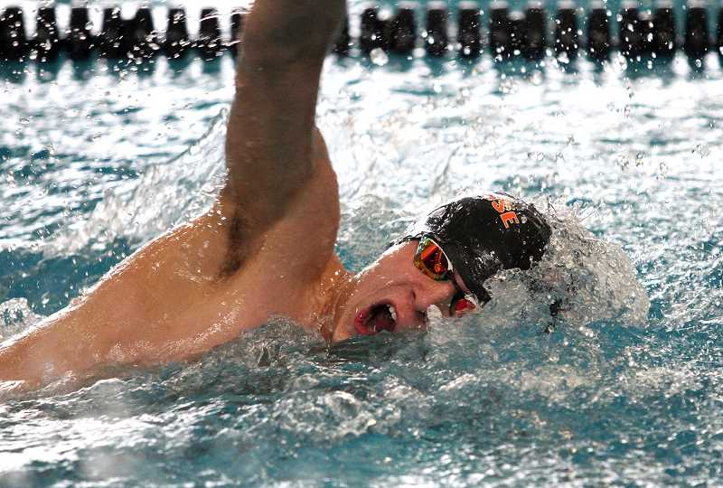 SPOTLIGHT PHOTO: MILES VANCE - Scappoose sophomore Will Blair churns through the 100-yard freestyle during the Class 5A state meet meet at Tualatin Hills Aquatic Center on Friday. , South County Spotlight - Sports Sophomore Will Blair finishes fourth and sixth in his two individual races to lead Indians Scappoose boys race to 14th at 5A state swim meet