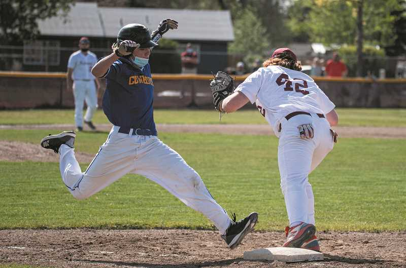 LON AUSTIN - Mitch Warren works to beat out an infield play, but came up a few inches short. The Cowboys, which fielded a very inexperienced team this spring, lost in the first round of the IMC tournament to Redmond, 11-5. They'll expect to field a more experienced squad in 2022.