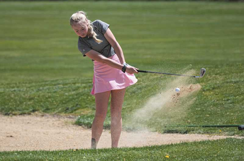 CENTRAL OREGONIAN - Merritt O'Gorman, shown here earlier in the season, finished in second place overall in the girls 5A golf tournament. O'Gorman led the Cowgirls to an eighth-place team finish. Brothers Hogan and Palmer Smith led the Cowboys in the state tournament, both shooting rounds of 87, tying for 12th overall. As a team, the Cowboys finished sixth.