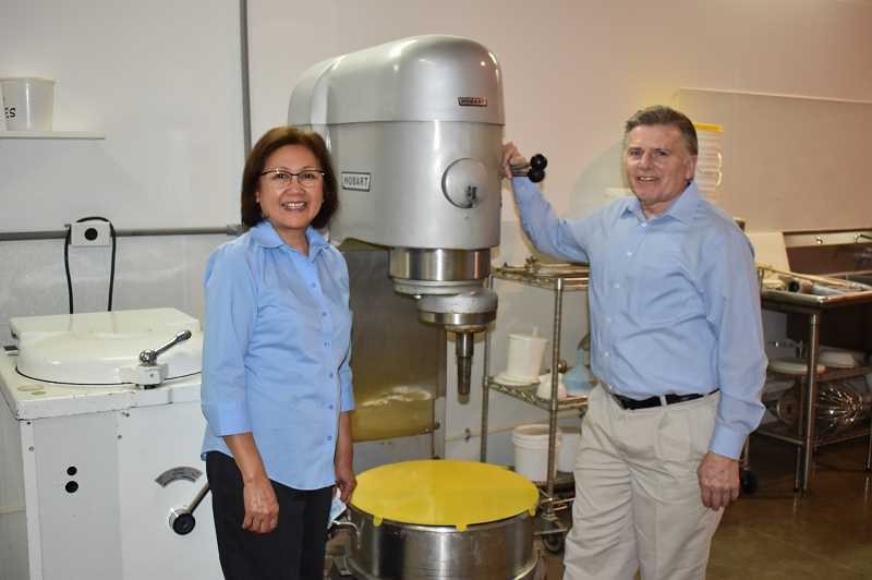 RAMONA MCCALLISTER - Ron and Yolanda Jahn, owners of Creative Foods, Inc., stand in front of some of the equipment used for processing their Vege Steaks.