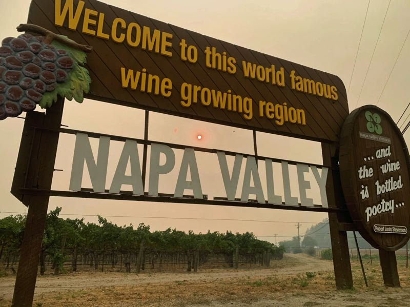 COURTESY PHOTO: BILL WADELL, ACCUWEATHER - A hazy and fiery shadow cast by wildfires over wineries in Northern California last year.