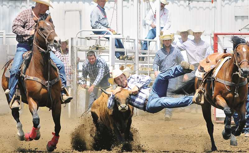 PMG FILE PHOTO - The rodeo will feature all spectators' favorite action, including steer wrestling, this year.