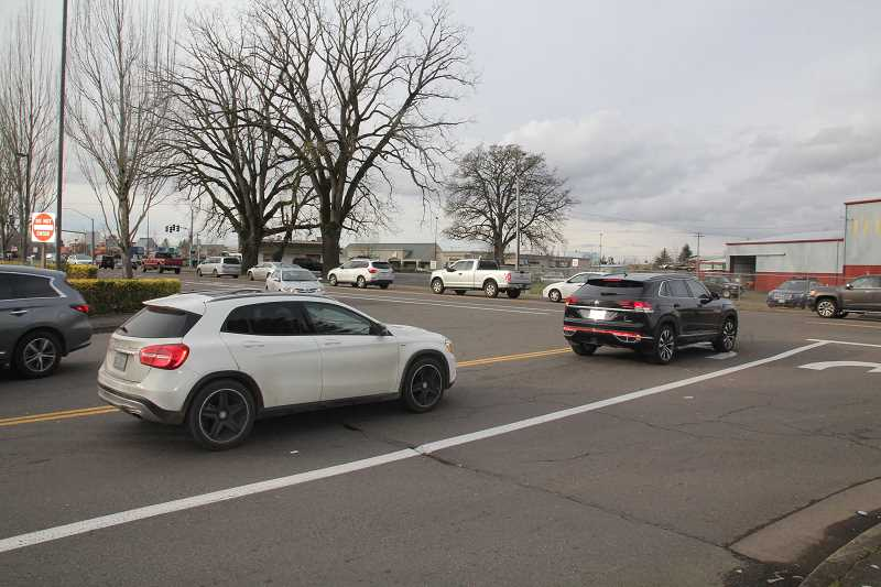 PMG PHOTO: JUSTIN MUCH - Entry from Safeway parking lot onto Molalla Road (Highway 211) is one of the concerns Woodburn city councilors expressed regarding a nearby proposed annexation and apartment complex development., Woodburn Independent - News