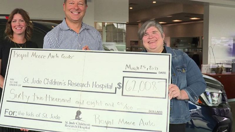 COURTESY KOIN 6 NEWS - Royal Moore Subaru in Hillsboro gave a check to St. Jude Children's Research Hospital on May 25.
