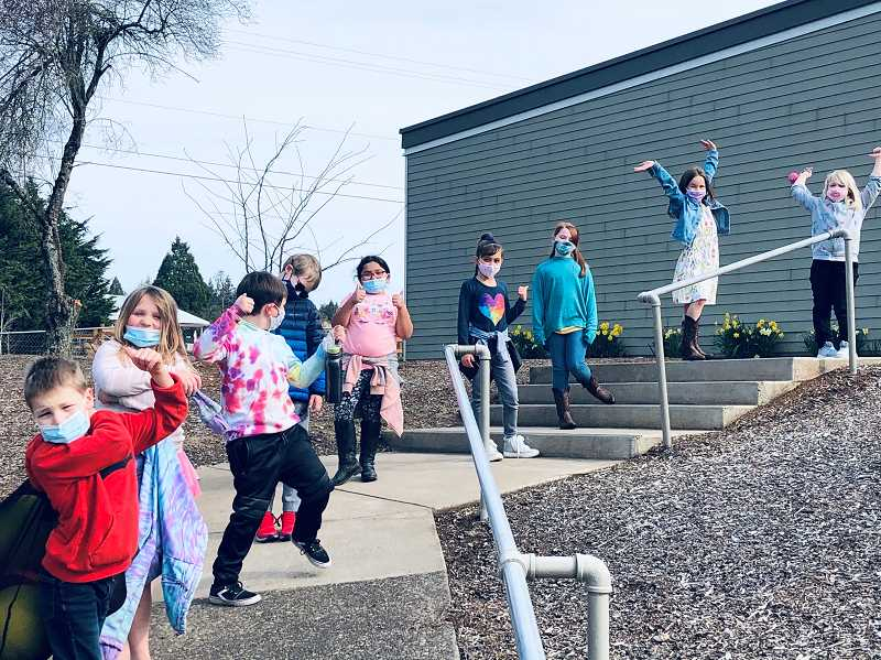 COURTESY PHOTO - Students at Carus Elementary wear masks and physically distance outside upon their return to the school buildings in March. Masks will no longer be required outdoors at Canby schools.