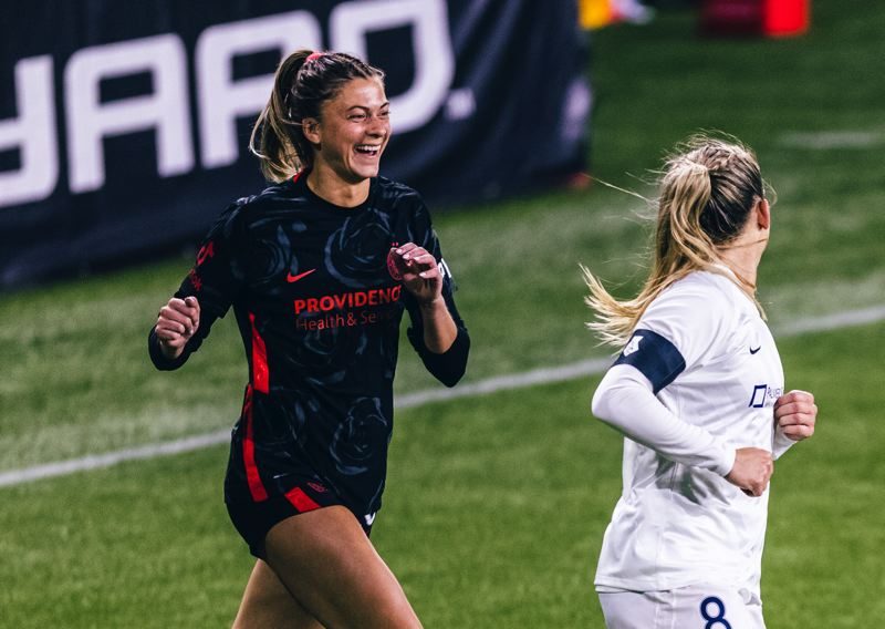COURTESY PHOTO: FLETCHER WOLD/ISI PHOTOS - A bubbly person off the field, Portland Thorns defender Kelli Hubly (left) shares a laugh with Kansas City forward Amy Rodriguez during an April 9 match at Providence Park.