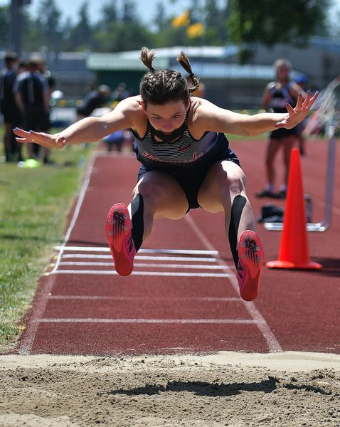 COURTESY FILE PHOTO: ANDRE PANSE - Kennedy senior Emma Beyer scored 22 of the Trojans' 33 points at the 2A state championship showcase, including a state championship in the triple jump with a leap of 33-03.