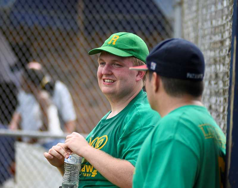 COURTESY PHOTO - ABO Commissioner and Exectuve Director Taylor Duncan (left) talks with a coach during an ABO game. Duncan, who himself is autistic, started the league in 2016.