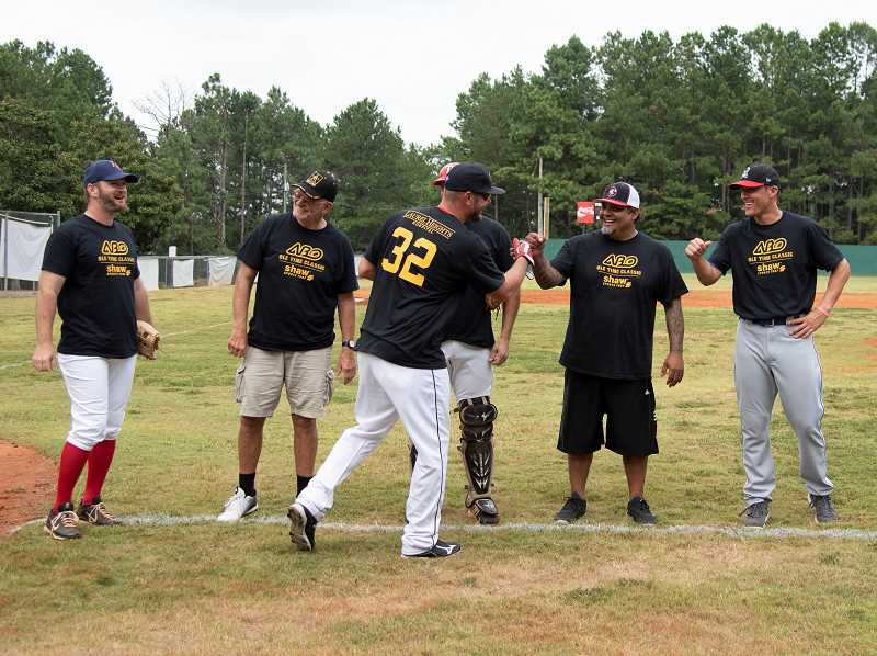 COURTESY PHOTO - Members of the ABO slap high-fives during player introductions prior to a game in Georgia. The Alternative Baseball Organization is presently in 12 states with over 70 teams.