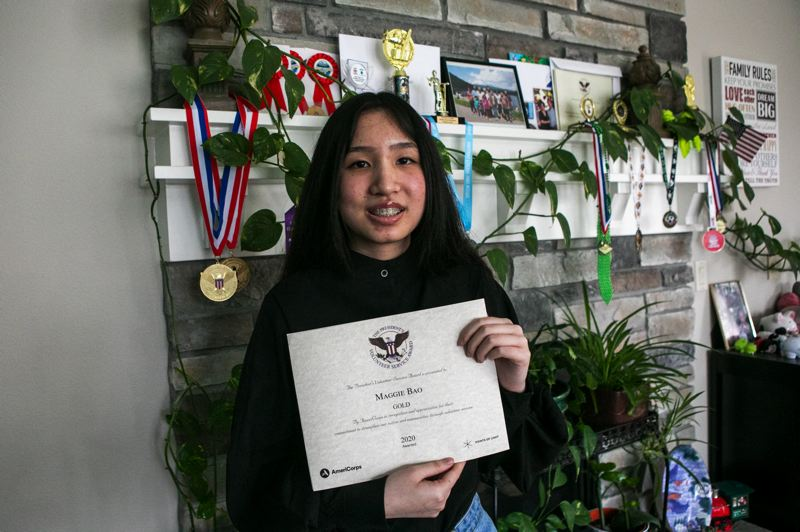 PMG PHOTO: JAIME VALDEZ - Maggie Bao, 16, holds her second President's Volunteer Service award. Bao earned the award in 2020 after 135 hours of service that year.