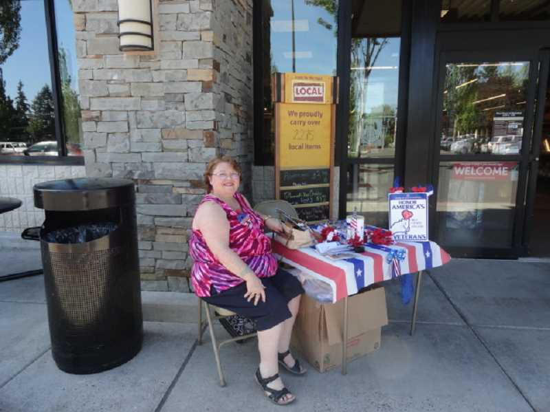 COURTESY PHOTO - Patti Webb, a member of the American Legion Auxiliary, volunteers to collect donations at the Milwaukie Safeway on May 22-23.