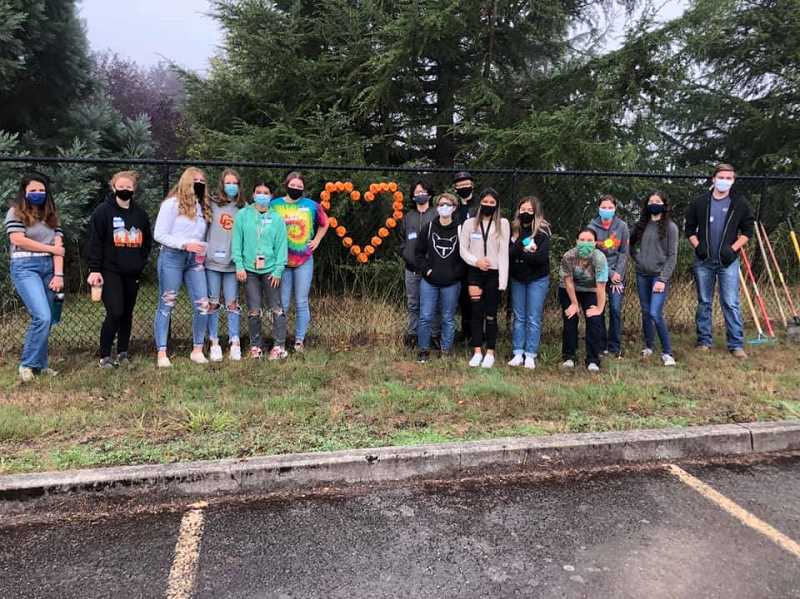 COURTESY PHOTO: MOLALLA FBLA - Molalla FBLA and Key Club members pose for a photo after a clean-up day in September.