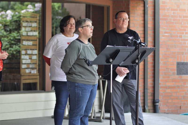 PMG PHOTO: WADE EVANSON - Ralph Brown's daughter-in-law Gretchen Brown speaks while Brown's daughter Laurie Saunders and son Daryle Brown stand in support during the family's press conference Wednesday afternoon, May 26, at the United Church of Christ in Forest Grove. Ralph Brown has been missing since he left his home in Cornelius May 16.