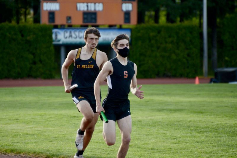 PMG PHOTO: ANNA DEL SAVIO - Scappoose senior Gage Ekstrom leads in the last leg of the 4x400 relay in early May. Columbia County, meanwhile, is trailing behind in the race to get residents vaccinated and get our economy and society back to normal.