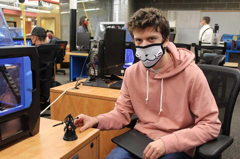 PMG PHOTO: KRISTEN WOHLERS - Canby High School student Anthony Topliff shows off a figurine he created using a 3D printer.